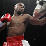 Floyd Mayweather Jr. (L) of the U.S. punches at WBA super welterweight champion Miguel Cotto of Puerto Rico during their title fight at the MGM Grand Garden Arena in Las Vegas
